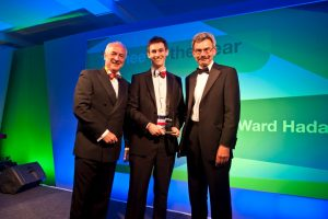 Terrific trainee – James Fairman of Ward Hadaway (centre) accepts the Trainee of the Year Award at the Northern Law Awards from (left) awards compere Colin Briggs of BBC Newcastle and (right) Geoff Harrison, Visiting Professor at Northumbria University.
