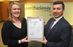 High standards – Ward Hadaway information security manager Jennifer Kilmartin receives the ISO 27001 status certificate from BSI UK & Ireland training director Shahm Barham.