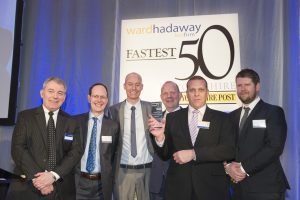 Advanced Forwarding receive the award for Fastest Growing Medium Sized Business - from left are Philip Jordan of Ward Hadaway; John Cridland of Transport for the North; Nick Kay, Ben Balfour and Rory Watts of Advanced Forwarding and Yorkshire Post editor James Mitchinson.