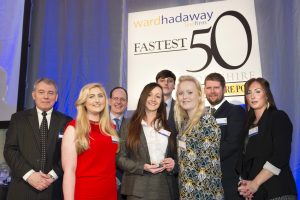 Fastest growing small company winners Pet Brands (front, from second left) Rachel Barrass, Charlotte Parker, Ben Ledgerd, Chelsea Reeves and Donna Hoyle receive their trophy from (left) Phil Jordan of Ward Hadaway (third from left) John Cridland of Transport for the North and (second from right) James Mitchinson of The Yorkshire Post.